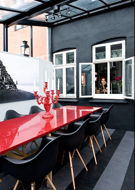 Outdoor Dining with Red Table and Black DSW Chairs