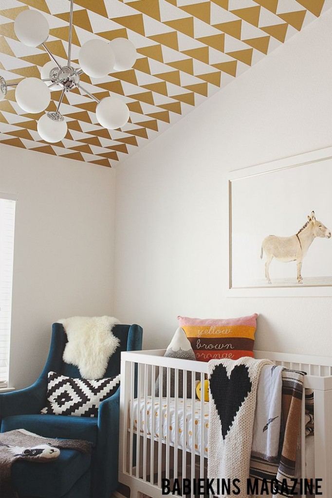 Tasteful Nursery With Gold Wallpapered Ceilng