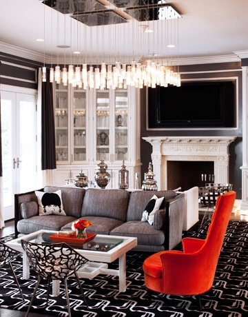 Black White and Grey Living Room with Bursts of Red