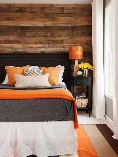 Earthy Masucline Bedroom With Orange Pop