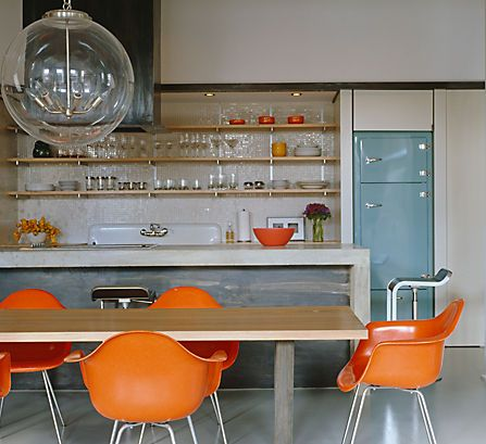 Modern Dining With Orange Chairs