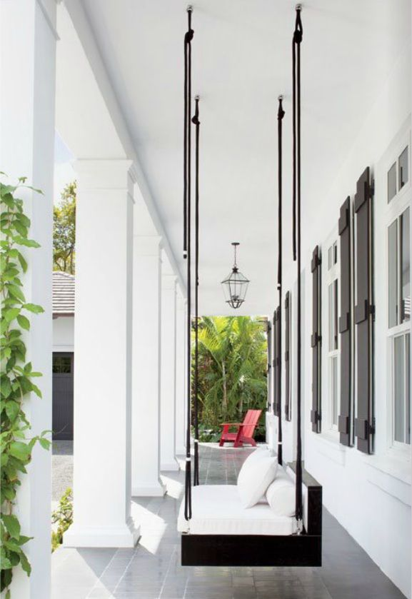 Modern Porch Swing On Black And White Deck