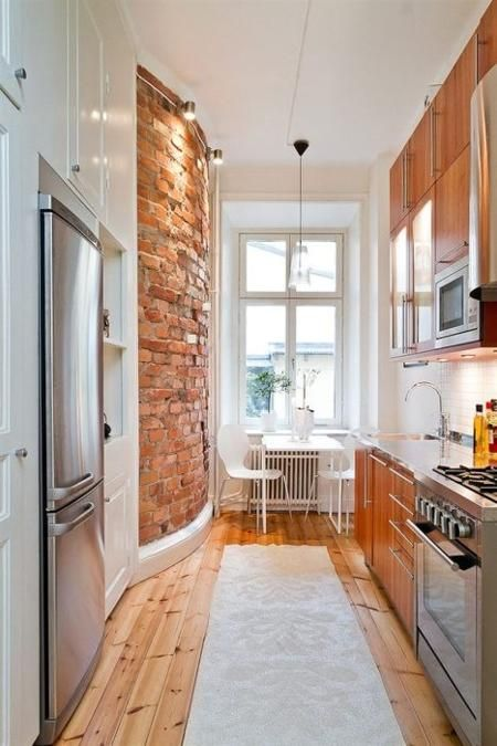 Shotgun Kitchen with Exposed Brick Wall