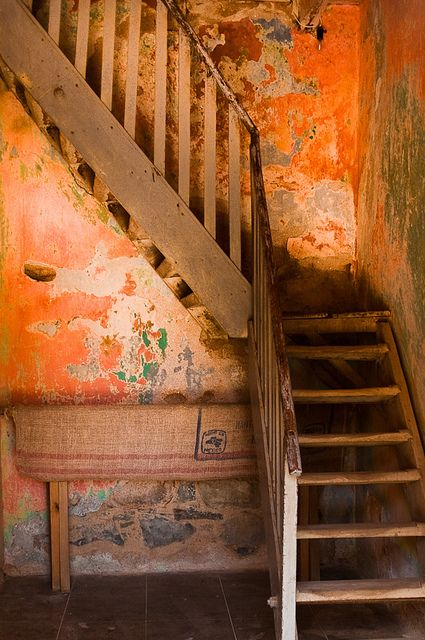 Rustic Staircase with Orange Walls